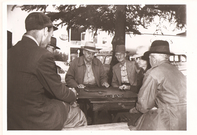 Men playing domino game on Courthouse lawn in Oxford, MS